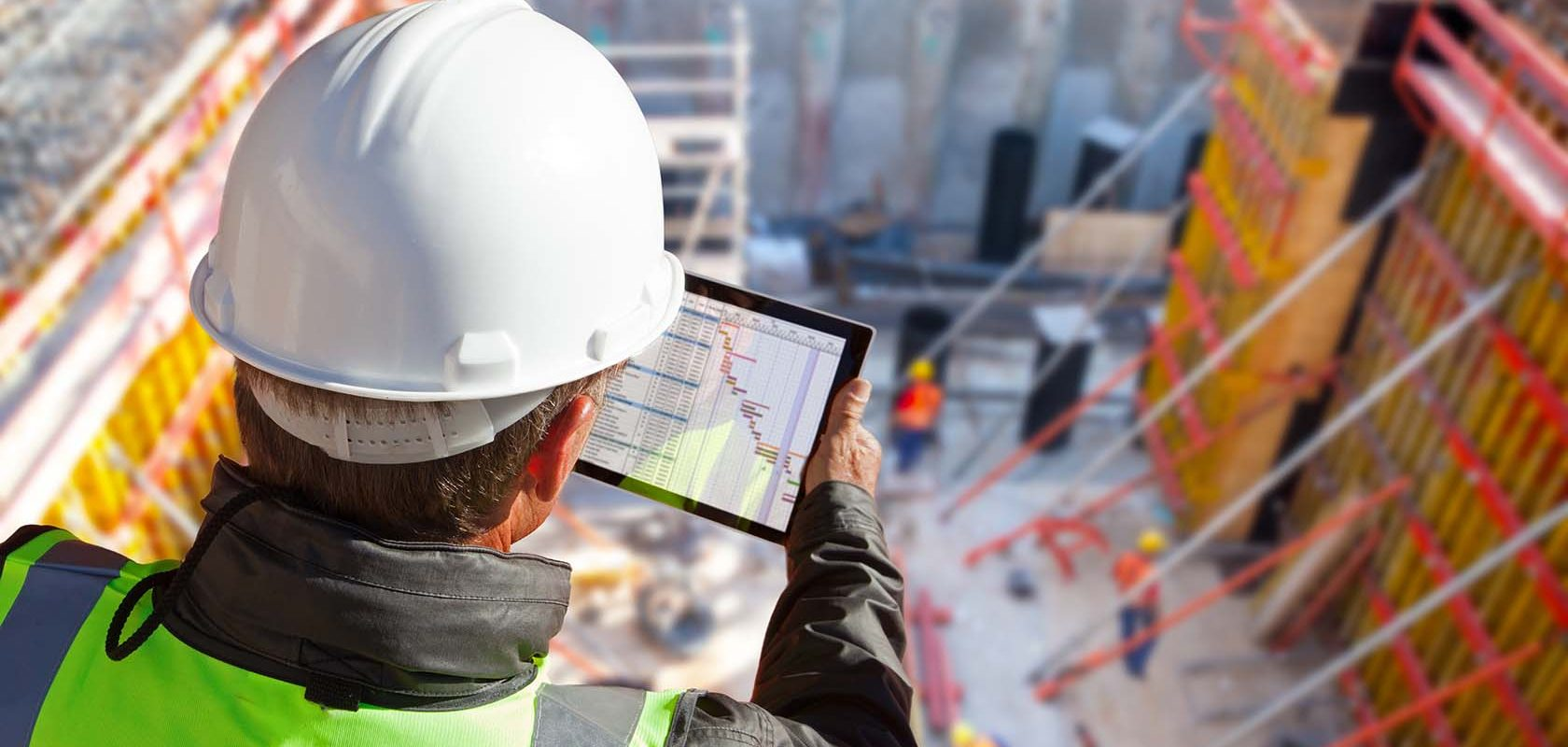 civil engineer or architect on construction site checking schedu
